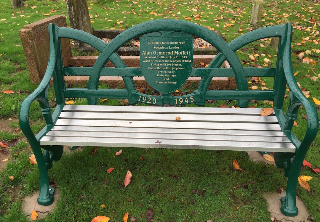 memorial bench with badge